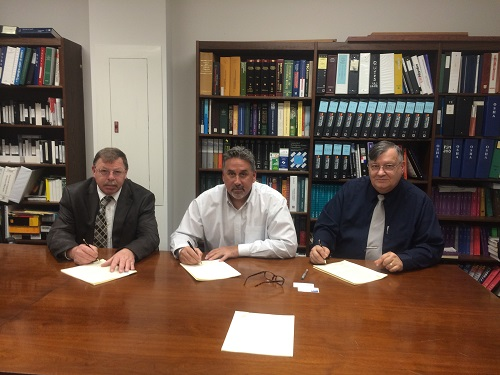 Left: Kenneth C. Tucker, lll (Director, CONN-OSHA Wethersfield, CT Office); Anthony Maselli (Vice President of Field Operations, KBE); and Robert W. Kowalski (Area Director, Bridgeport , CT Area OSHA Office). (PRNewsFoto/KBE Building Corporation)