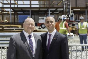 Ron Simoneau, Vice President of Shawmut Design and Construction, stands with Providence Mayor Jorge Elorza during a topping off ceremony for the Shawmut-built Brown University School of Engineering building, located at 345 Brook Street in Providence, RI.
