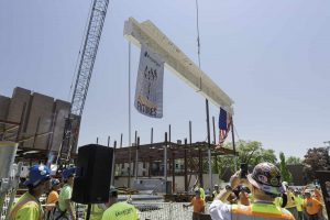 A beam signed by hundreds of member s of the Brown University community is raised into place during a topping off ceremony held recently for the 80,000 square foot School of Engineering building, located at 345 Brook Street in Providence, RI.