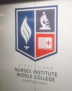 RI Nurses Institute Middle College installation of logo, opaque white 3M™ Scotchcal™ Electrocut Film and 3M™ Scotchshield™ Safety & Security Film on classroom glass wall panels.