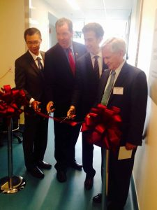 (l-r) Interim Executive Director and Medical Director of the Boston Public Health Commission Dr. Huy Nguyen, MLSC Vice President for Communications and Marketing Angus McQuilken, Chief Scientific Officer at Dana-Farber Barrett Rollins, MD, Dana-Farber President and CEO Edward J. Benz Jr., MD. participate in a ribbon-cutting ceremony to celebrate the official opening of Dana-Farber's Molecular Cancer Imaging Facility in Boston's Innovation District.