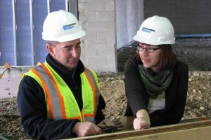 Tiffany King consulting with Ed Corey, Senior Superintendent, at the 1265 Main Street project site in Waltham, MA.