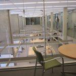 Professor's office overlooks work stations and mezzanine hallway.
