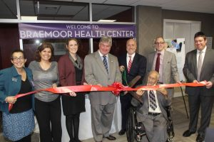 (l - r) Janet Catton, director of nursing services for Braemoor health center, Helena silva senior executive director for Braemoor and Brockton Health Centers, Alison Van Dam from metro west chamber of commerce, Mike Brady-state senator, Bill Carpenter Mayor of Brockton, Charlie Johnson president of the resident council at Braemoor health center, Zisha lipshutz co-owner of synergy health centers, Dov Newmark co-owner of synergy health centers.