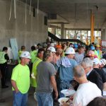 Members of the design/build team mingle with Lesley University staff at the topping off ceremony.