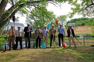 Groundbreaking ceremony held across the Winnipesaukee River from the future site of the River's Edge Apartments in Laconia. Paddles were held instead of shovels to pay homage to the site's proximity to the River.