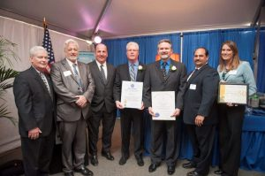 (l-r) Avon Board of Selectman Chairman Frank Hegarty, Avon Selectman Robert Brady, State Senator Brian Joyce, Weiss Sheet Metal owners Brian DeLano and Wayne DeLano, Bob Costa, President of the Avon Industrial Park Association, and Alison Van Dam, Vice –President, Metro South Chamber of Commerce. Weiss Sheet Metal received proclamations from the Massachusetts House of Representatives, Massachusetts State Senate, and the Metro South Chamber of Commerce