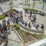 """UCU's public plaza features granite benches, multiple garden beds, and a Schoodic Symposium sculpture by Teng Shan Chi, called """"Dragon."""""""